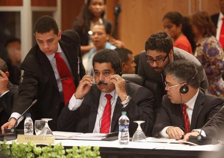 Venezuelan President Nicholas Maduro sits among other officials as he attends a plenary session with CARICOM leaders at the 40th Heads of go