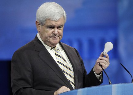 Former U.S. House Speaker Newt Gingrich (R-GA) holds up a light bulb in remarks about the Republican Party's need to innovate, to the Conser