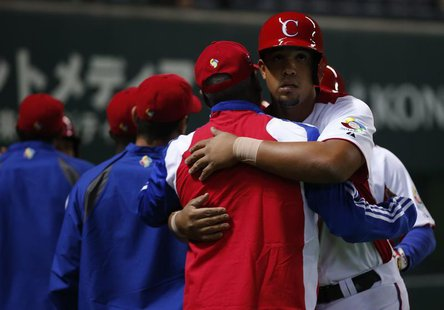 Cuba's Jose Abreu reacts with teammates after hitting a grand slam off China's Liu Yu in the fifth inning at the World Baseball Classic (WBC