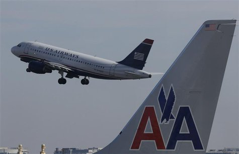A U.S. Airways jet departs Washington's Reagan National Airport next to American Airlines jets outside Washington, in this February 25, 2013