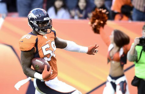 Denver Broncos' Von Miller trots into the inzone after intercepting a pass from Tampa Bay Buccaneers Josh Freeman during their NFL football
