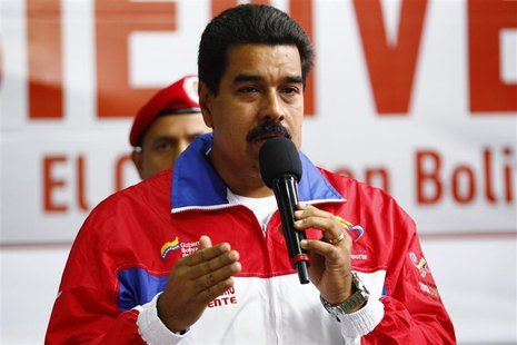 Venezuela's President Nicolas Maduro speaks during the inauguration of a funicular at Petare slum in Caracas August 14, 2013. REUTERS/Carlos