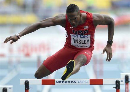 Michael Tinsley of the U.S. clears a hurdle in the men's 400 metres hurdles heat during the IAAF World Athletics Championships at the Luzhni