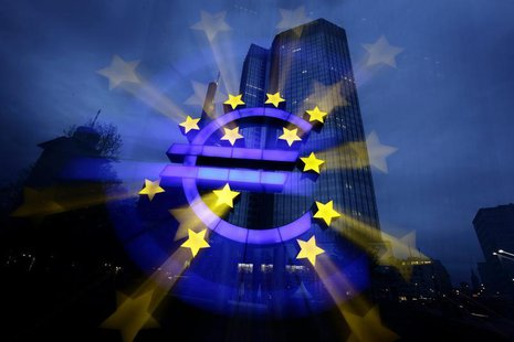 A zoom-burst image shows the illuminated euro sign in front of the headquarters of the European Central Bank (ECB) in Frankfurt April 5, 201