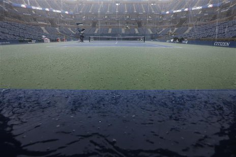 A general view of the Arthur Ashe Stadium during a downpour at the U.S. Open tennis tournament in New York September 8, 2012. REUTERS/Kevin