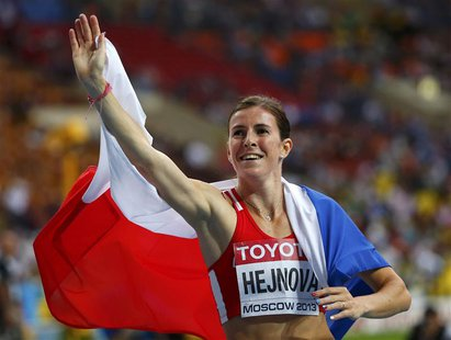 Zuzana Hejnova of Czech Republic waves as she celebrates winning the women's 400 meters hurdles final during the IAAF World Athletics Champi