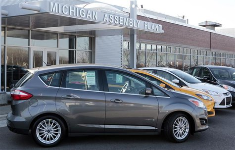 A Ford 2013 Ford C-MAX Hybrid vehicle is seen on display outside the Michigan Assembly Plant in Wayne, Michigan November 8, 2012. REUTERS/Re