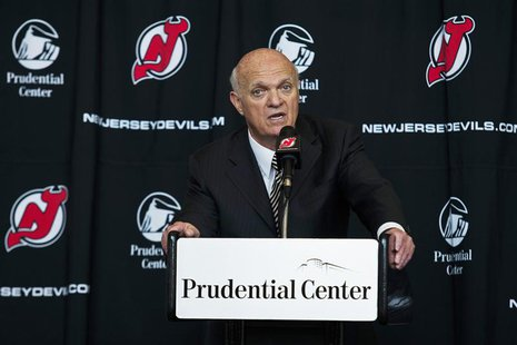 New Jersey Devils general manager Lou Lamoriello speaks to the media while he attends an NHL hockey news conference announcing the new owner