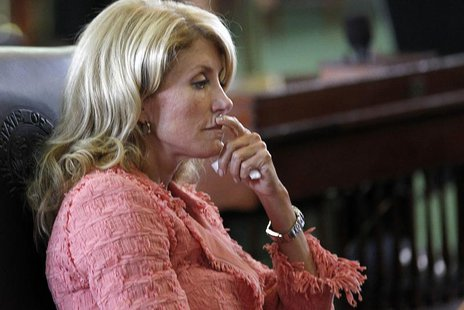 Texas state Democratic Senator Wendy Davis listens as the state Senate meets to consider legislation restricting abortion rights in Austin,