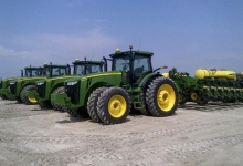 Four John Deere tractors and planters for sale sit on a lot in IllinoisReuters/Tom Polansek