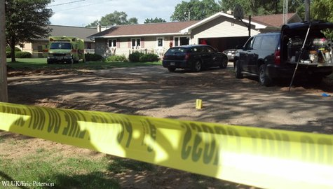 Authorities investigate a home on S. Water St. in Wautoma Aug. 15, 2013, one day after a robbery suspect broke into the home and held officers at bay. (Photo by: FOX 11).