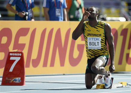 Usain Bolt of Jamaica points upwards at the starting block before his men's 200 metres heat during the IAAF World Athletics Championships at