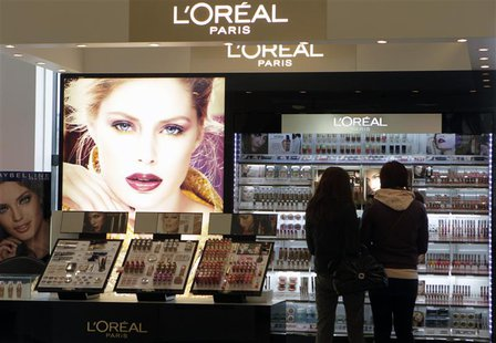People look at L'Oreal cosmetics in a shop in Riga April 13, 2012. REUTERS/Ints Kalnins