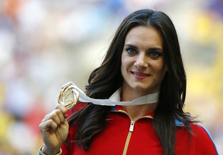 Gold medallist Yelena Isinbayeva of Russia holds her medal at the women's pole vault victory ceremony during the IAAF World Athletics Champi