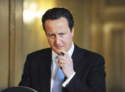 Britain's Prime Minister David Cameron listens to a question during a news conference at Number 10 Downing Street in London March 14, 2013.