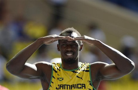 Usain Bolt of Jamaica looks on before his men's 200 metrers heats during the IAAF World Athletics Championships at the Luzhniki stadium in M