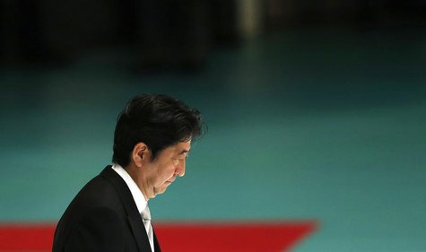 Japan's Prime Minister Shinzo Abe attends a memorial service ceremony marking the 68th anniversary of Japan's defeat in World War Two, at Bu