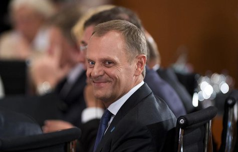 Polish Prime Minister Donald Tusk waits at the start of the conference of European leaders on the fight against mass youth unemployment in E