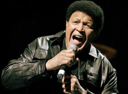 "Rock legend Chubby Checker sings his trademark song ""The Twist"" at Denver Nuggets basketball game in Denver, Colorado, in this March 22, 200"