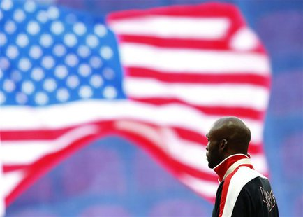 Gold medallist LaShawn Merritt of the U.S. listens to his national anthem during the victory ceremony for the men's 400 meters at the IAAF W