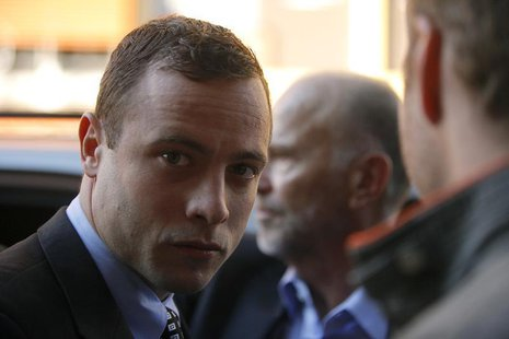 Oscar Pistorius arrives at the Pretoria Magistrates court for a brief appearance June 4, 2013. REUTERS/Mike Hutchings