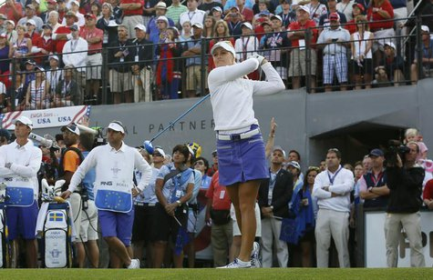 Anna Nordqvist of Sweden hits off the first tee during the Friday morning foursomes matches at the 2013 Solheim Cup at Colorado Golf Club in
