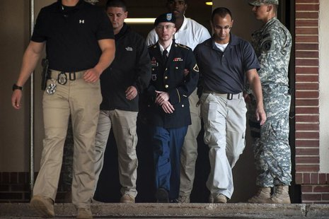 Private First Class Bradley Manning is escorted out of court after testifying in the sentencing phase of his military trial at Fort Meade, M