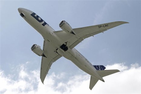 Boeing 787 Dreamliner belonging to Polish airline LOT flies after taking off from the Chopin International Airport in Warsaw June 1, 2013. R