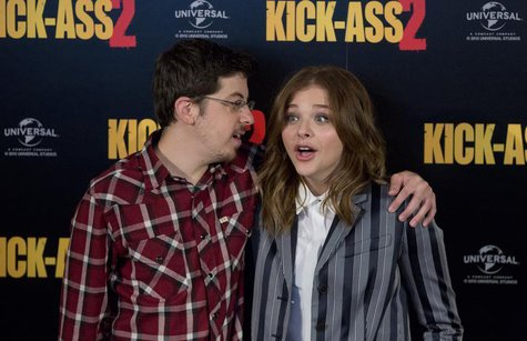 "Actors Christopher Mintz-Plasse and Chloe Grace Moretz (R) pose during a media event for the film ""Kick Ass 2"", in London August 5, 2013. RE"