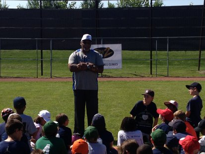 Former Tiger's first baseman Cecil Fielder talks to over 100 kids at Derek Jeter's Turn 2 Foundation baseball clinic at Mayors Riverfront Park in Kalamazoo