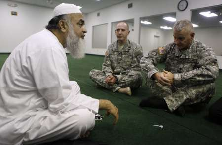 Imam Syed Ahmed Ali (L-R), Chaplain Jason Palmer, and Chaplain Ira Houck sit together at the Islamic Community Center in Killeen, Texas November 7, 2009. REUTERS/Jessica Rinaldi