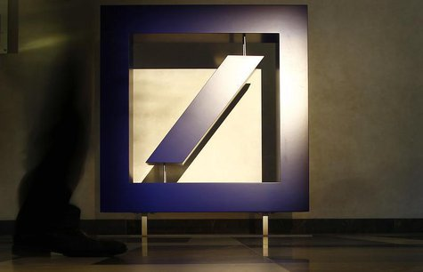 A visitor walks past the bank's logo prior to Deutsche Bank's annual news conference in Frankfurt February 2, 2012. REUTERS/Kai Pfaffenbach