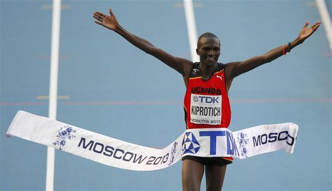 Stephen Kiprotich of Uganda celebrates winning the men's marathon during the IAAF World Athletics Championships at the Luzhniki stadium in M