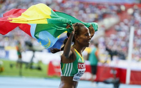 Meseret Defar of Ethiopia celebrates her victory in the women's 5000 metres final of the IAAF World Athletics Championships at the Luzhniki