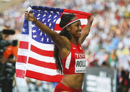 Brianna Rollins of the U.S. celebrates her victory in the women's 100 metres hurdles final during the IAAF World Athletics Championships at