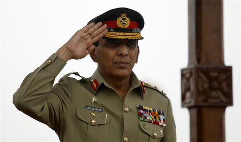 Pakistan's Chief of Army Staff General Ashfaq Parvez Kayani salutes during a parade while on a visit to the Sri Lanka Army headquarters in C