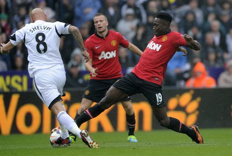 Swansea City's Jonjo Shelvey (L) is challenged by Manchester United's Danny Welbeck during their English Premier League soccer match at Libe