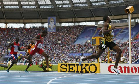 Usain Bolt (R-L) of Jamaica finishes to win ahead of Curtis Mitchell of the U.S., Churandy Martina of the Netherlands and Jaysuma Saidy Ndur