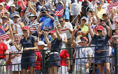 (Front L-R) Jessica Korda, Morgan Pressel and Paula Creamer of Team USA encourage fans on the first tee during the Friday afternoon four-bal