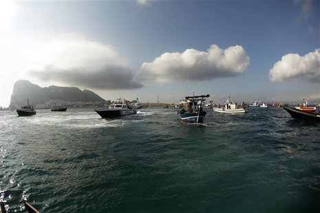 Gibraltarian police (L-2nd L) and the Spanish Civil Guard (3rd L) in their boats, work together to monitor a protest by Spanish fishermen in