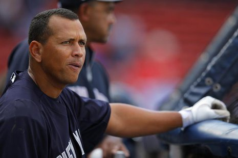 New York Yankees third baseman Alex Rodriguez warms up before the Yankees' American League baseball game against the Boston Red Sox at Fenwa