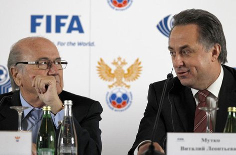 FIFA President Sepp Blatter (L) and Russian Sports Minister Vitaly Mutko attend a news conference in St. Petersburg January 20, 2013. REUTER