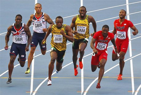 (L-R) Dwain Chambers of Britain takes the baton from teammate James Ellington, Usain Bolt of Jamaica takes the baton from teammate Nickel As