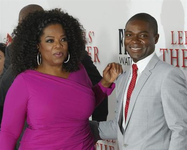 "Actors David Oyelowo and Oprah Winfrey, cast members of the film ""Lee Daniels' The Butler"", pose at the film's premiere in Los Angeles Augus"