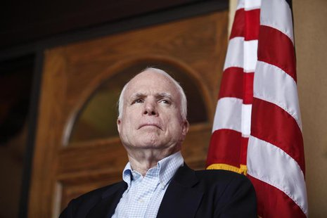 U.S. Senator John McCain (R-AZ) watches his colleagues speak during a news conference following their tour of the Arizona-Mexico border in N