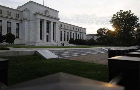 The sun rises to the east of the U.S. Federal Reserve building in Washington, July 31, 2013.REUTERS/Jonathan Ernst