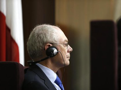 President of the European Council Herman Van Rompuy listens to Malta's Prime Minister Joseph Muscat's reply to his address to the Maltese pa