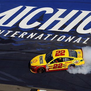 Joey Logano burns rubber after crossing the finish line first Sunday to win the Pure Michigan 400 at M.I.S.  PHOTO CREDIT: LAT USA/Michigan International Speedway
