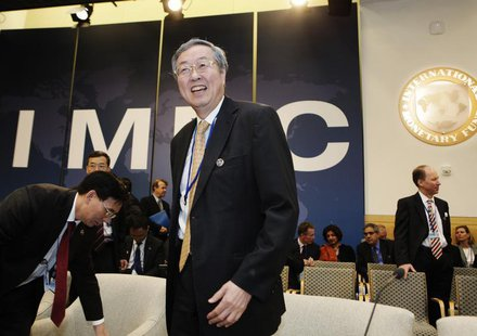 Governor of the People's Bank of China (PBOC) Zhou Xiaochuan (C) arrives at the International Monetary and Financial Committee (IMFC) meetin