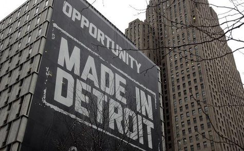 "A large ""Opportunity Made In Detroit"" banner is seen on the side of one of the buildings owned by Quicken Loans founder Dan Gilbert in downt"